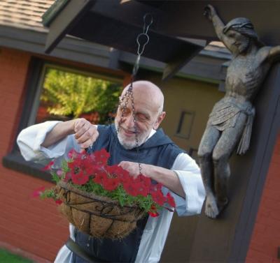 Fr. John tending his plants